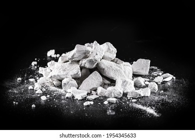 Calcium and Magnesium stones, black background. Called virgin lime or quicklime