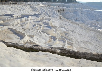 The calcium travertines at Pamukkale (Hierapolis), Turkey, near Denizli. Tourists can walk on the hot spring water travertine. Most of the Travertines are dry because of tourism.