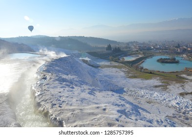 The calcium travertines at Pamukkale (Hierapolis), Turkey, near Denizli. Tourists can take hot air balloon to see the travertine. Most of the Travertines are dry because of tourism.