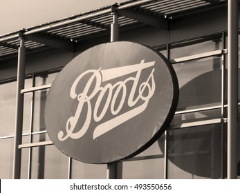 Calcot, Reading, Bath Road, Berkshire, England - October 03, 2016: Sepia Boots the Chemist sign over store, company established in 1849 by John Boot