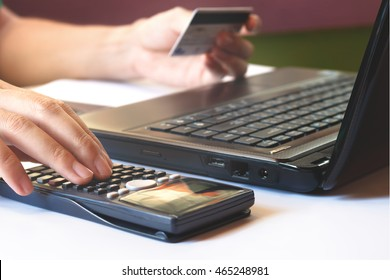 Calculate how much cost or spending have with credit cards used for e-commerce.