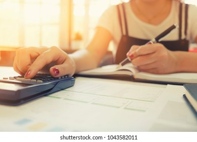 Calculation of business cropped shot of woman using calculator with calculate business finance data vintage tone.