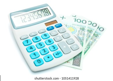 Calculator and 100 Polish Zloty banknotes on white background