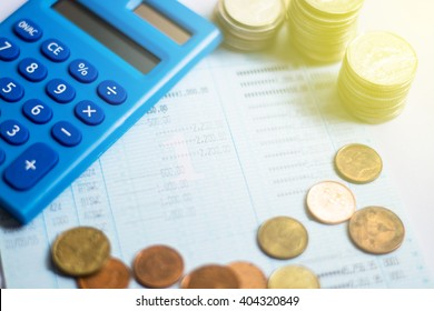 calculator account book and coins
