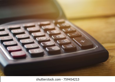calculator for accounting on wood background in vintage style