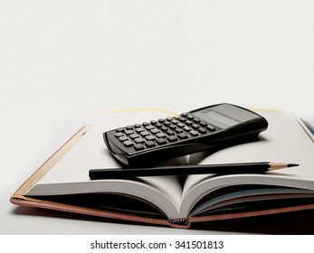 calculator ,and diary , and pencil to take notes