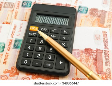 calculator, ball pen and some Russian banknotes closeup