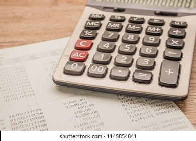 Calculator, bankbook Put on a wooden table.