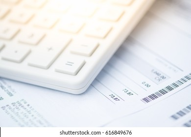 Calculator and bill payment as background. Income, expenses, tax, financial data.