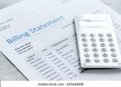 calculator, billing statement for doctor's work in medical center stone background