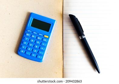 Calculator blue on book , Calculator blue with book