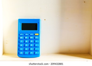 Calculator blue on book , Calculator blue with book