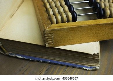 Calculator and book in the wooden table
