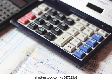 Calculator and building plans. Building planes for a new house, isolated.
