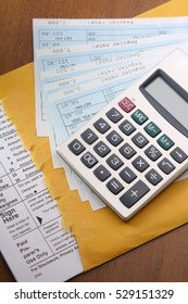 Calculator with business paper on the desk