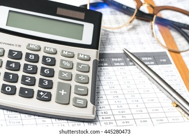 Calculator button plus, glasses coin pencil and mouse on graph paper background