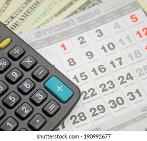 calculator, calendar and dollars