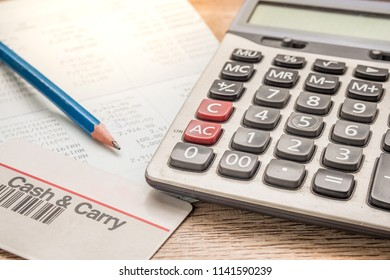Calculator, cash card, pencil, bankbook Put on a wooden table.