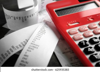 Calculator with checks on table. Tax concept
