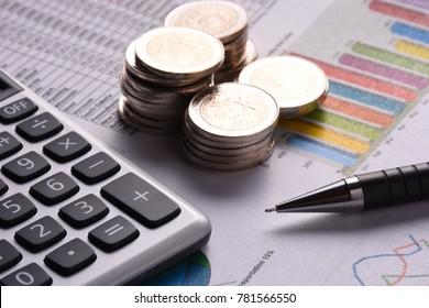 Calculator and coins con a financial sheet