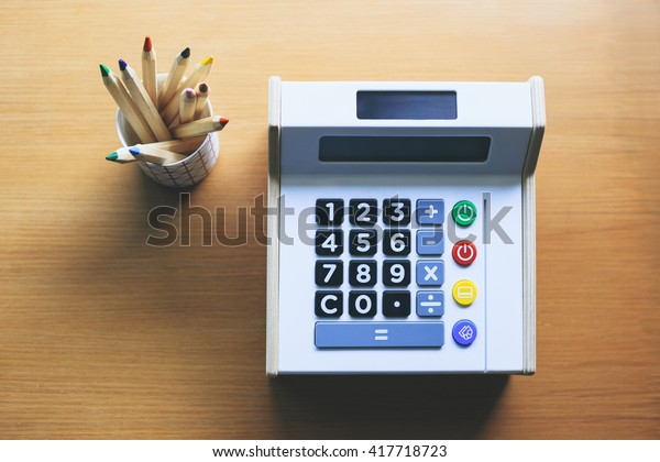 Calculator with color pencils on table Money saving Budget control Financial management Start up concept