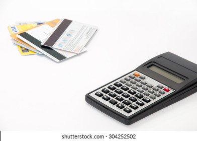 Calculator with credit cards in the background.