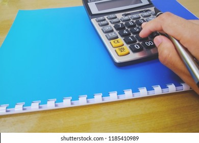 calculator with  document  on  table  office background.business finance saving planning  account concept.