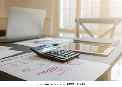 calculator and documents that have been prepared on the table in the meeting room to prepare for the meeting to summarize the annual results. Document preparation concepts before the meeting
