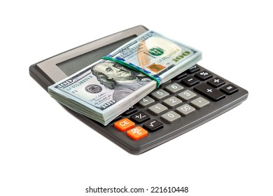 Calculator and dollars on the white background