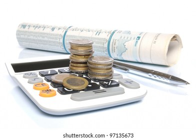 Calculator with Euro coins, ball pen and stock market report on white background