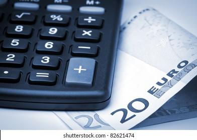 Calculator and euro money.