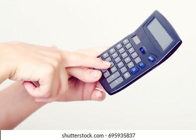 calculator in female hands