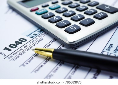 Calculator and Form 1040 US Individual Income Tax Return. Financial development, Banking Accounting, Statistics, Investment Analytic research data, Business company meeting concept.