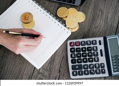 calculator and golden bitcoin. Cryptocurrency investors concept.