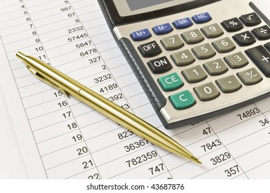 The calculator and the handle on a paper with figures