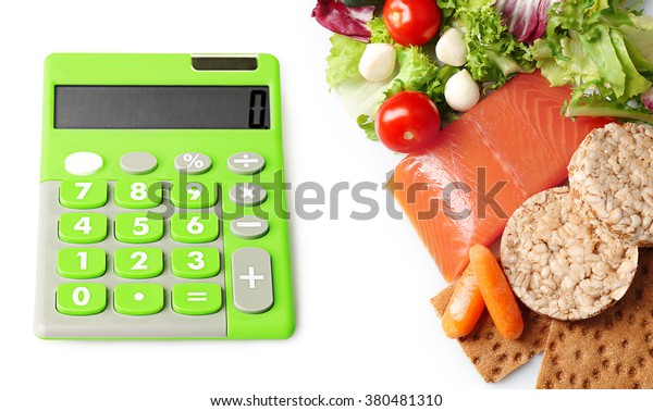 Calculator and healthy food set isolated on white