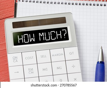 Calculator with how much? Calculator with how much? and notepad, pen on background