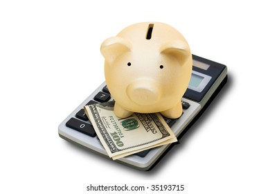 A calculator with hundred dollar bills and a piggy bank isolated on a white background with clipping path, calculating your savings