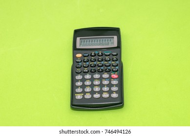 calculator isolated on green background. Office equipment for paperwork.