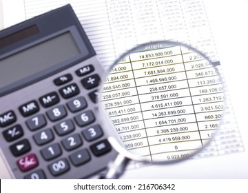 Calculator and Magnifier on Financial balance and accounting figure data.