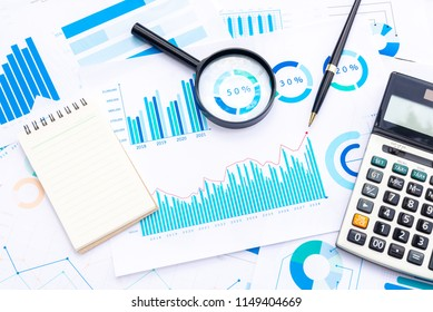 Calculator and Magnifying with Business Graphs finance document.