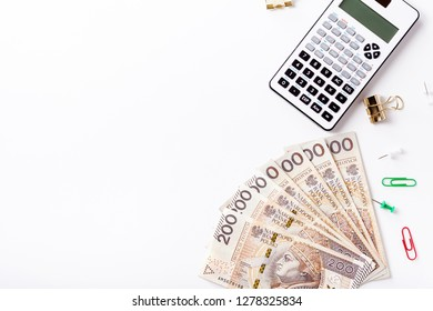 Calculator and money on white background, polish currency, polish zloty, banknotes