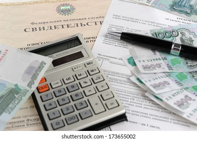 Calculator, money, pen and tax act against the background of the certificate close
