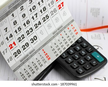 Calculator, notebook and calendar