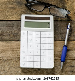 Calculator with notepad and glasses