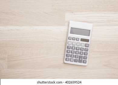 Calculator in office on empty stone table. Concept of financial business, education or household economy.