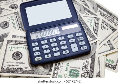 calculator on the background of hundred-dollar bills
