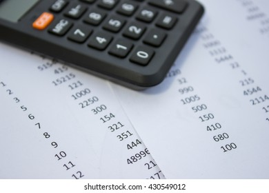 calculator on business report Financial accounting stock market graphs analysis