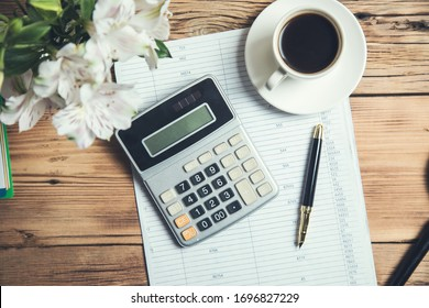 calculator on document and coffee on the table