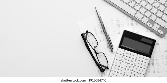 Calculator on financial statement and balance sheeet on desk of auditor. Concept of accounting and audit business.